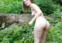 Nerdy natural amateur strip teasing in the woods #14