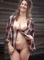 Naturally busty girl Livia teasing outdoors in the rain #11