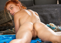 Redhead amateur Flora masturbating in back of van #14