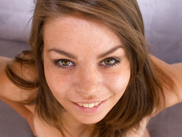Pretty teen Bonnie Shai on her knees for a facial