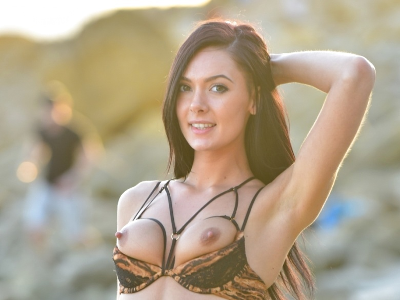 Marley Brinx teasing in her bikini at the beach