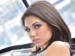 Curvy brunette Darcie Dolce strip teasing indoors