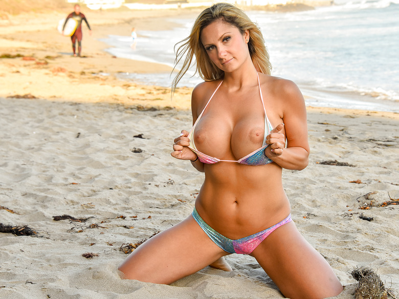 Nikkia busty milf posing in the sand in Beach Beauty
