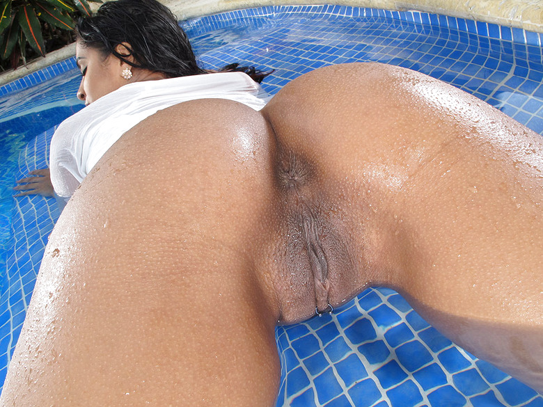 Exotic babe Abby Lee Brazil showing juicy ass in pool