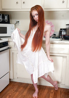 Dolly Little is a redhead teen showing her pink gap #01