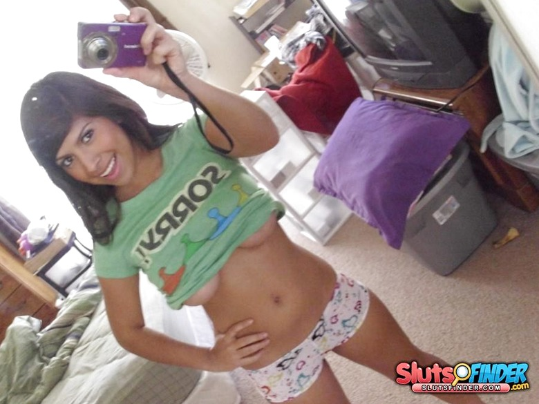 Young teasing cutie Sandy showing off her body at home
