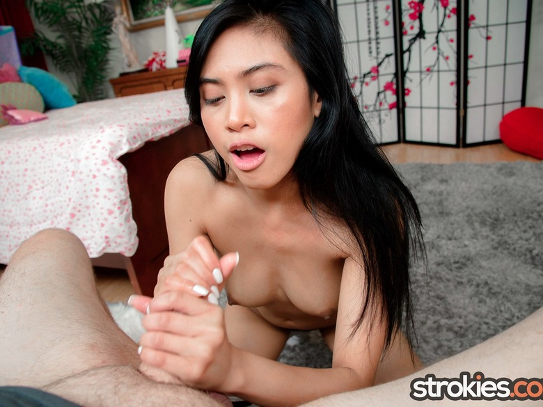 Ember Snow gets on her knees and strokes a dick
